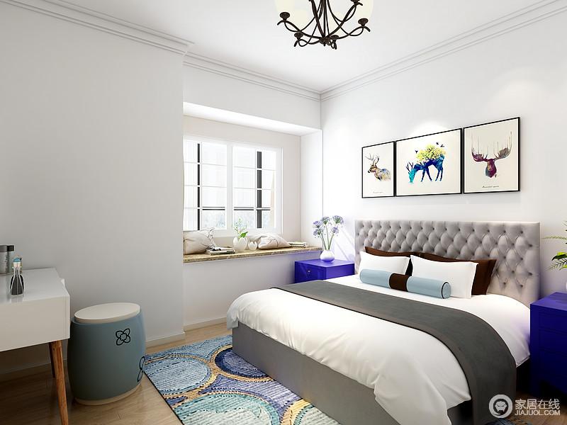 卧室在硬装的设计和施工上较为简洁,力求白净平整,彩色动物画注入紫色之余,也缓解了单一;飘窗的设计让空间更为通明,而彩色圆圈地毯搭配浅灰色罗马纽扣地床头、灰白色床品,让生活满是温情和张力。