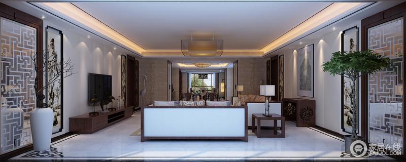 客厅的白色吊顶因为暖黄的灯带,渲染出了和暖温馨,再加上通透的玻璃矩形灯作为陪衬,令空间轻妙了不少;立面通过对称的方式陈列着中国写意画,在一花一器的陪衬中,赋予生活东方气韵。