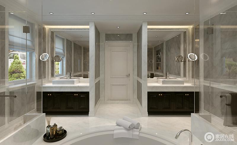 卫生间以灰白色砖石铺贴空间,两个盥洗区与淋浴区对称,延续矩形设计之余,极大地提升了生活的实用性和质感;白色台面搭配黑色盥洗柜,简洁利落,足够大气。