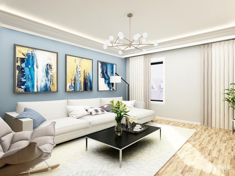 客厅以浅灰色和蓝色漆粉刷墙面,三幅抽象地挂画组合提升了空间的色彩,满是艺术气息;白色地毯和沙发搭配黑色茶几,简洁大气,实用舒适,现代摇椅和时尚的吊灯组合出生活的别致。