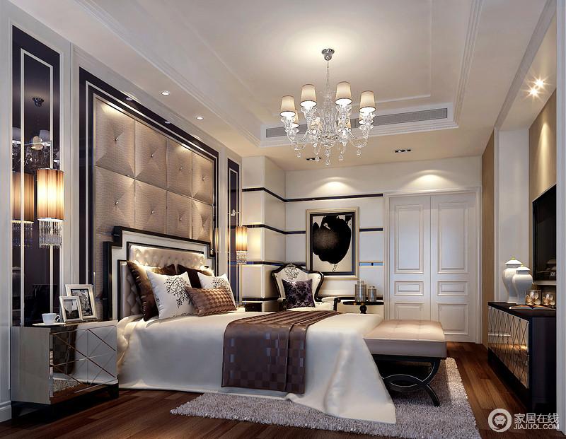 卧室线条规整,黑白板材相间打造得几何墙搭配褐色软包及镜面装饰背景墙,不仅体现了现代利落,更是裹挟着一股奢华;水晶筒形吊灯搭配简欧水晶灯张扬了晶莹剔透之光,与空间中的镜面床头柜、边柜,黑色绣花沙发、黑白色的挂画,混搭出了精致的艺术之韵,让家更为华贵。