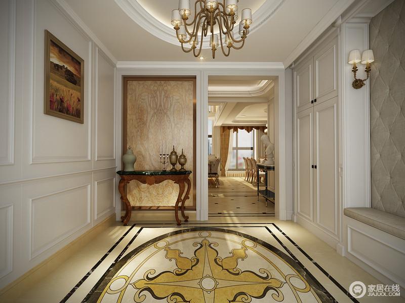 门厅的设计以矩形板材来装饰,并定制了储物柜,满足收纳,同时,因为白色调设计给人自然而又静逸的感受;椭圆形的吊顶与米黄色拼花砖的造型相和,让家充满暖调之余,多了份华丽。