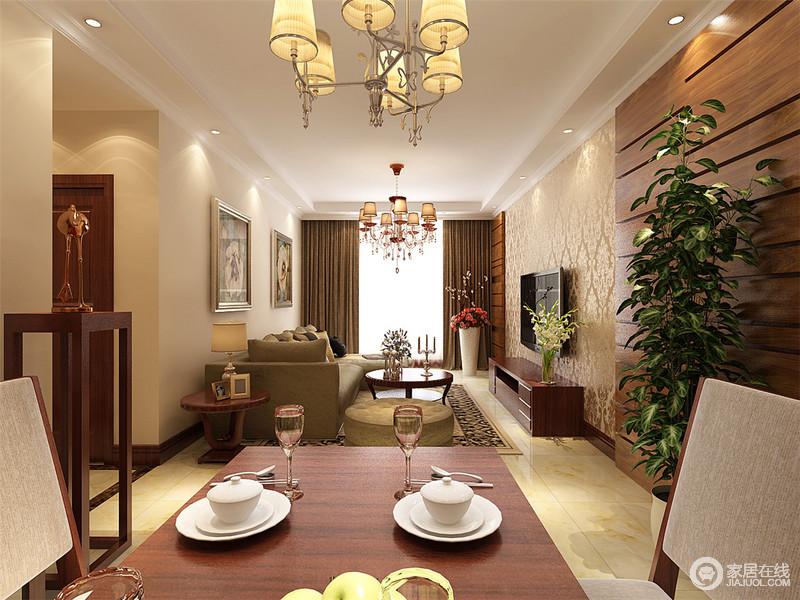 开放式的空间让人更为自在,动线自然而然地与餐厅做了区分;餐厅区墙面以褐色实木作护墙板,与实木家具组合奠定空间的稳重,博古架上的饰品调和出了生活的艺术气息。