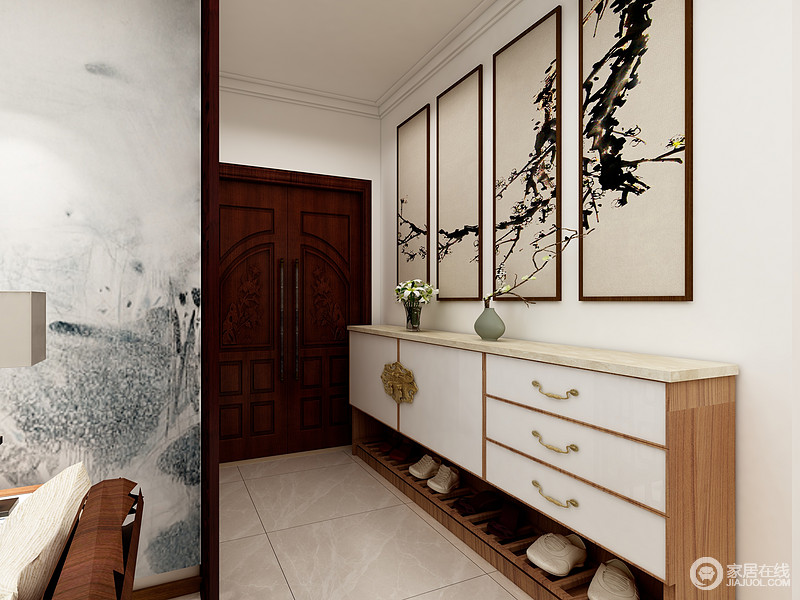 门厅放了一排矮柜来充当鞋柜,上面一排装饰画丰富了纯色的空间,白色柜门的跳色丰富了空间色彩,放上几株绿植或者器物让空间富有生机感。