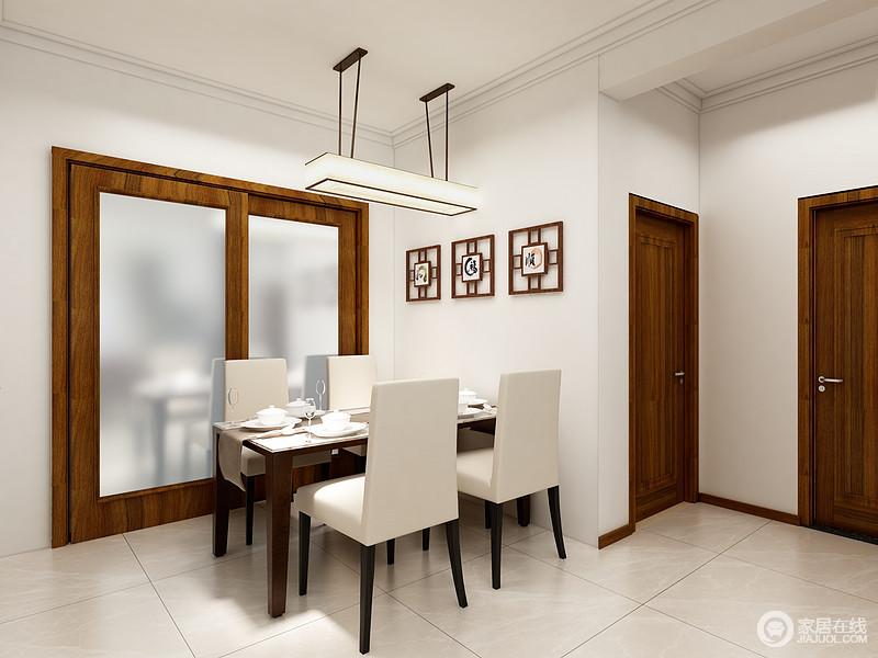 餐厅相对而言比较简单,因为不能抢了客厅的风采,白色的墙面上一排中式装饰木制饰品足显东方之韵;吊灯在地砖上的映射让空间的亮度上升了好几个档次,搭配颇为现代的家具,更为大方。