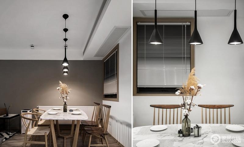 灰白色的桌面,木质的餐桌椅,简单随性搭配,便让用餐多了份朴质;简约风的吊灯和花器,装饰出工业利落和生活的隽意。