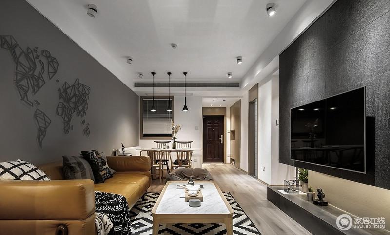 棕色皮质沙发给灰色墙面色彩的点缀,让原本原木和灰色打造的沉静,多两分明快;黑白几何纹样的地毯和靠垫,装饰出时尚。