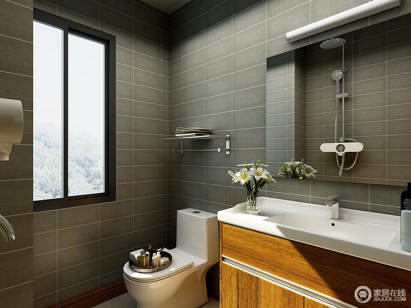 卫生间的墙面以灰色文化砖来铺贴空间,奠定了空间内中国式的沉静和素雅,却与现代设计利落简洁构成空间的亮点;而褐色原木盥洗柜搭配镜面柜,让盥洗更为清爽和便利。