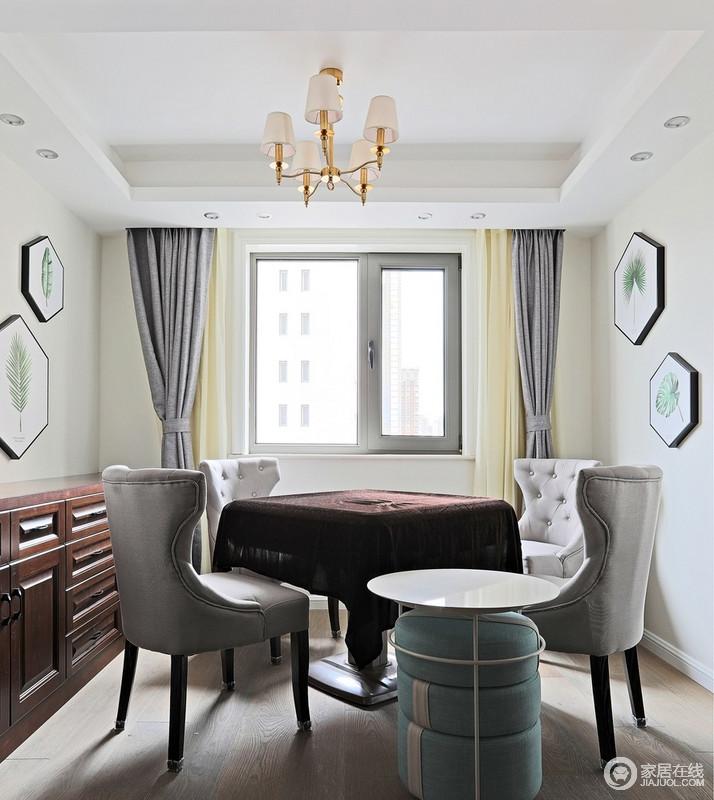 休闲室粉刷成了浅米色,搭配米黄色窗帘,显得清暖温馨,而深灰色窗帘搭配美式古典单椅赋予空间高冷和些许复古轻奢;墙面青色叶子的多边形画缓和了胡桃木家具的厚重,搭配现代风的边几,让生活多了份惬意和轻松。