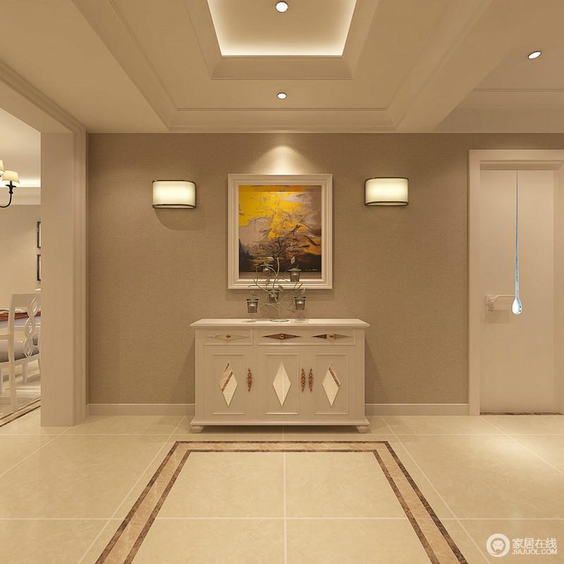 门厅没有太过繁复的设计,现代的线条足够简洁利落,正如吊顶与砖线的简单装饰便成就了空间的几何美学;边柜上的树枝摆件与黄韵的挂画,让空间有色彩,也有艺术感。