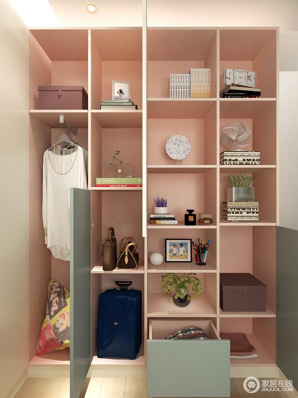 书房内定制的储物柜通过几何格子的形式实现有序地收纳,让主人的生活更为简单、省事儿;粉色搭配豆绿色的板材尽显时尚,同时极具质感。