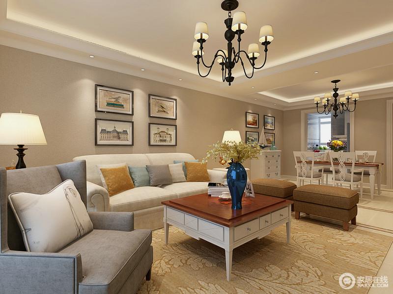 客餐厅一体式设计赋予生活更多的自在和舒适,中性为主色的空间,造就了温实;现代美式的沙发组合带着蓝色、土黄色的靠垫,多了色彩点缀的空间,也愈发有了明丽;不管是对称的桌几与台灯,还是挂画组合,都让生活更为温情。