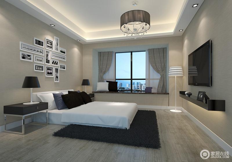 卧室被粉刷成了驼灰色,与地板的颜色相近,渲染了一个朴质、安适的氛围,但是,从照片墙的黑白色,到空间黑白色系的家具组合,以现代经典的色彩与简洁的设计,成就空间的利落大气。