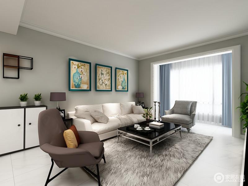 空间以白色地砖与吊顶呼应,同时与深灰色的墙面构成反差,灰白之间,张扬冷静之美;现代沙发组合虽然色彩不同,却以冷色调,彰显现代大气,白色橱柜搭配收纳架、挂画,让家颇显都市格调。