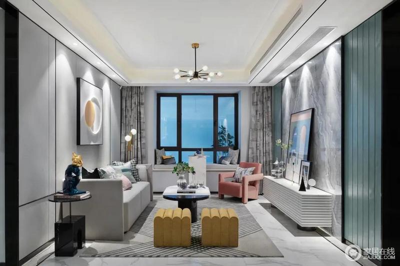 客厅以现代风的空间硬装基础,在色调方面加入黄色、粉色与青色的设计,结合灰色布艺沙发,在华丽优雅的空间下,呈现出一种活跃而时尚的高级空间感。