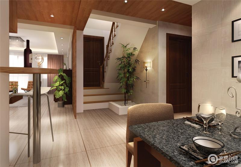 开放式的设计,因为建筑设计更显结构美学,一楼的餐厅与吧台相距不远,以实木为主的设计前提下,搭配现代元素的家具,让生活自在和放松。