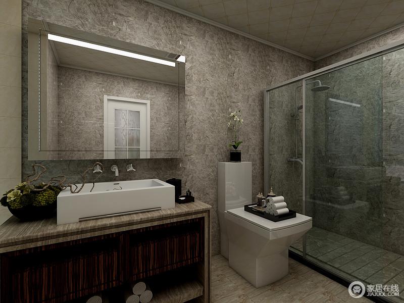 卫生间干湿分离的处理,减少了打理上的麻烦,褐灰色的砖石具有高冷气质,搭配白色盥洗盆,有种高级感。
