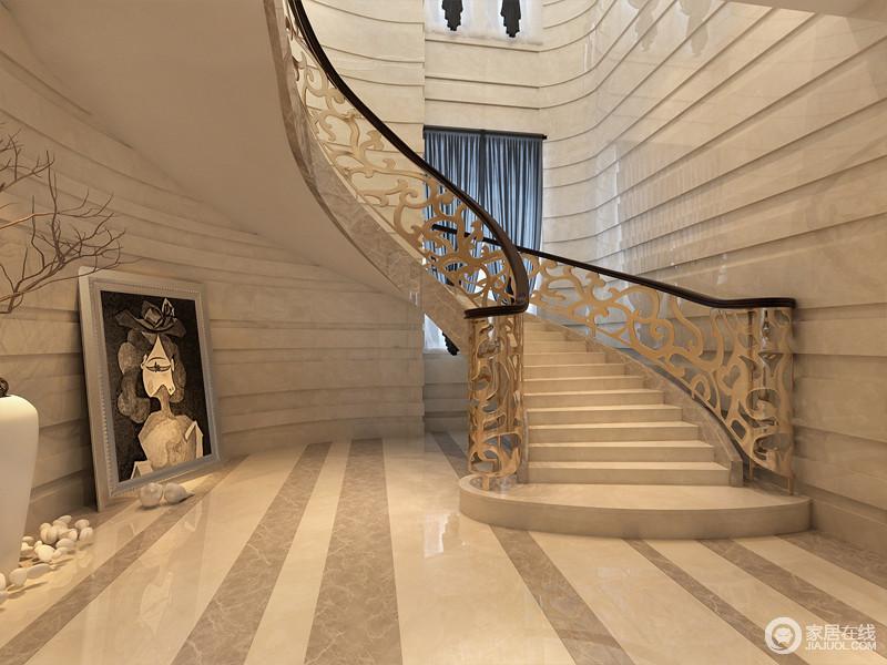 整个楼梯间的墙面,用极具立体的条块大理石铺贴,与条纹肌理的地面,制造出深邃的延展感,无形中拓宽了空间纵深;线条流畅的楼梯蜿蜒而上,雕花扶栏精致优美,赋予空间华丽贵气。