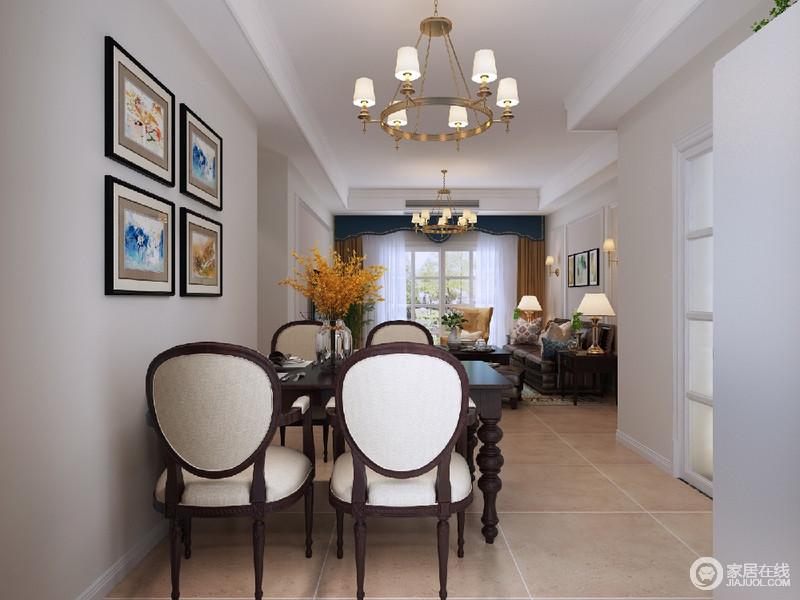 与客厅相连的餐厅,选用的是经典的美式餐椅,朴质大方中带着厚重优雅;对称墙画和瓶插的花艺,则点缀出几许艺术活力。