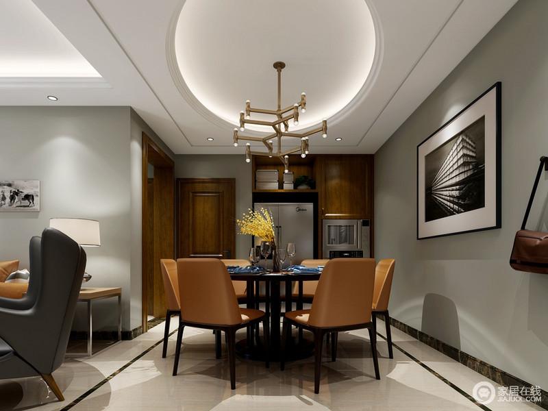 餐厅延续了客厅的色调和材质,使空间上保持风格的统一。深浅色调所凸显出的自然和都市质感,碰撞的相得益彰。圆形天花与圆桌的寓意,强调了家的氛围。