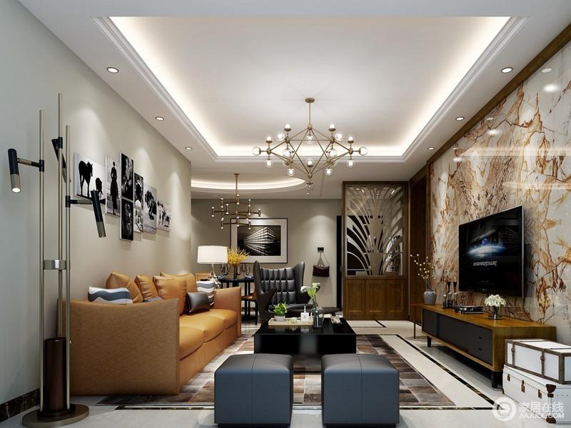 质感精良的黄色多人沙发搭配黑色、藏蓝色沙发椅、凳,空间的轻奢贵气感彰显了出来。电视墙上的泼墨画作,色调与多人沙发呼应。金属的灯具和复古的木箱,点缀出空间的雅痞范儿。