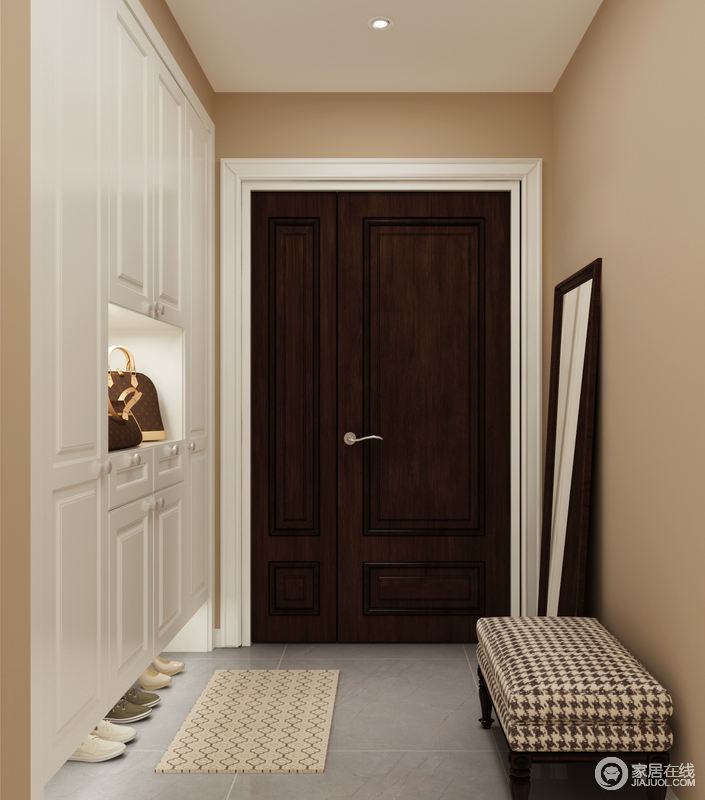 门厅无需太大,千鸟格纹路的换鞋凳搭配素净雅致的灰色地砖,与纯白色的超大储物柜构成色彩和谐,而米色的墙漆与之组合,彰显了主人内敛、低调、含蓄的家风,同时,平整之余给予视觉上的利落。