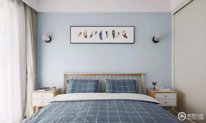 次卧没有多余的装饰,以简单实用为主,床头装饰画避免空间过于单调。