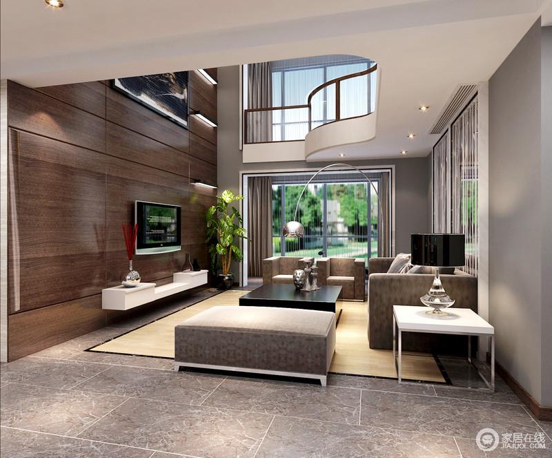 空间的墙面被粉刷成了浅灰色与灰色地砖奠定了空间的灰冷,设计师为了增加空间的利落,以褐色板材来装饰背景墙,平衡出了现代沉稳,而木色地毯的点缀,让空间升温不少;通透的玻璃增加采光,化解了灰色沙发和白色柜体组合的单调,让空间足够现代。