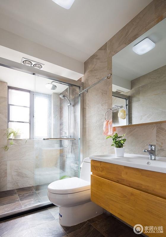 卫生间采取半开放式设计,用玻璃进行隔断,创造视觉延伸与丰富的空间变化感,马赛克砖石的运用增添了空间的趣味性,让空间足够天然而利落。