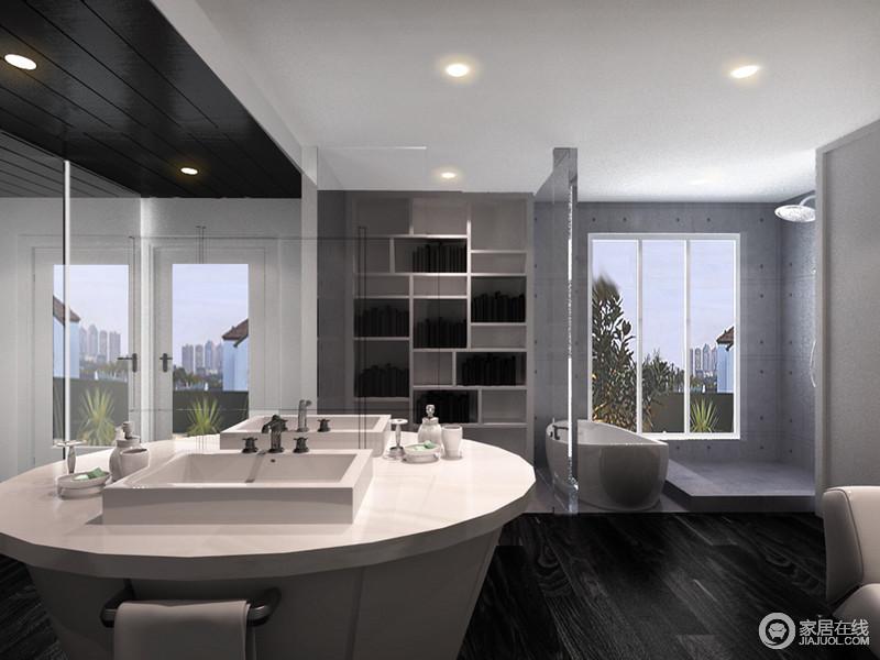 卫生间结构简洁方正,干湿分离的设计处理,让生活极为方便,也易于打理;墙面铺贴了黑色与灰色的装饰,银色填缝剂勾勒更有几何之美,圆形盥洗区让洗漱也变得豪气起来。