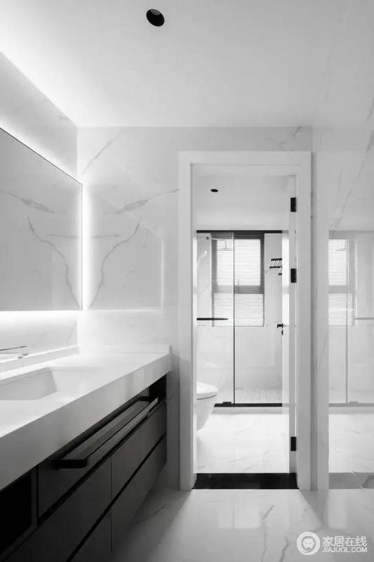 卫生间做了干湿分离的设计,整体色调为黑白色,与房间的整体色调所统一,白色的大理石使整个空间更加明亮。