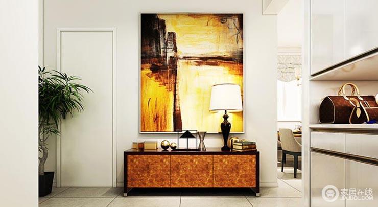 简洁大气的门厅柜,完美的收纳功能,让整个空间都显得整齐划一,现代时尚的挂画与端景台,让整个空间显得那么与众不同,让人眼前一亮。
